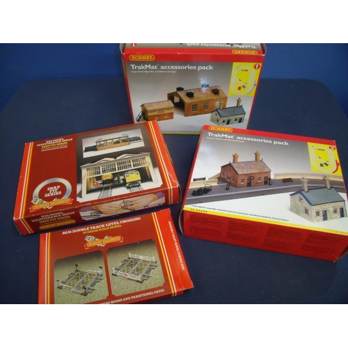 249 - Four boxed Hornby building pack accessories including diesel maintenance depot, country station and ...