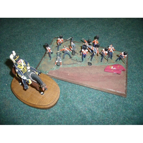 252 - Cast metal scale model of a 13th Hussar on wooden base and a group painted cast metal model set of a...