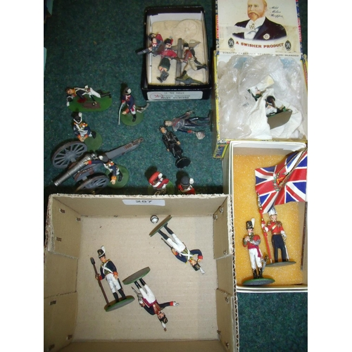 257 - Collection of cast metal military miniatures, mostly painted, including British Field Artillery Gun ...