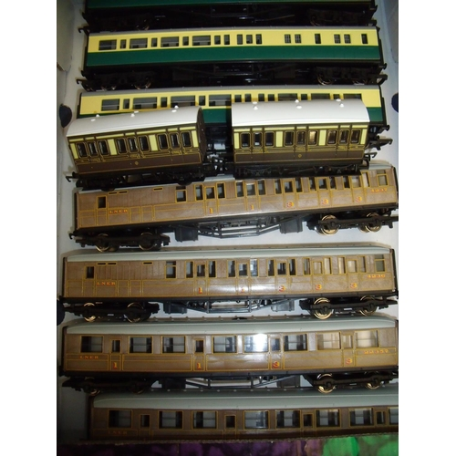276 - A set of three Hornby railway carriages, another set of four LNER Hornby carriages and two other car...