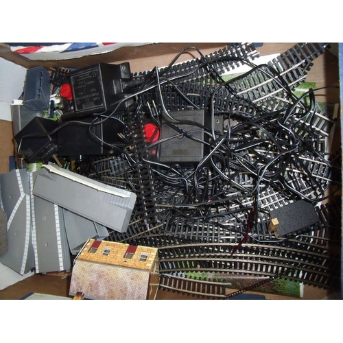 280 - Selection of OO gauge railway accessories including a quantity of track, platforms, control units, b...