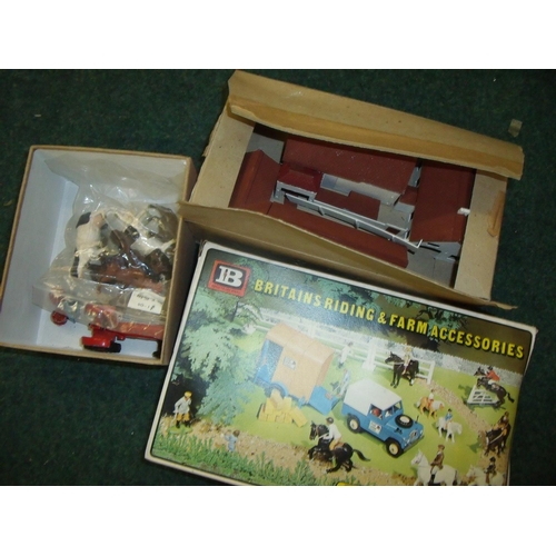 299 - Selection of model buildings, Britains farm animals, Britains boxed riding accessories set and a Din...