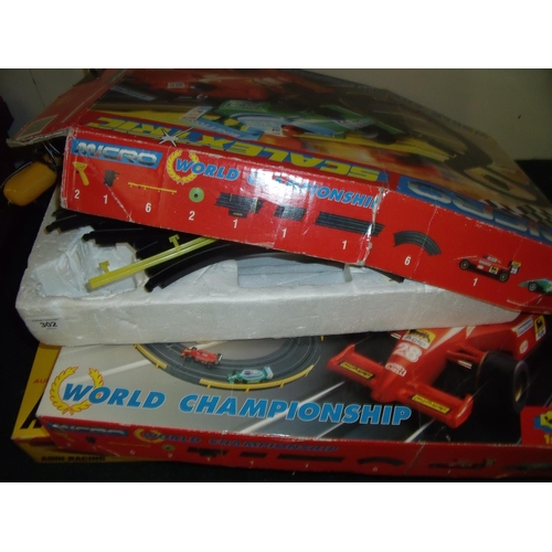 302 - Micro Scalextric set, Micro World Championship Scalextric type set and another similar (3)...