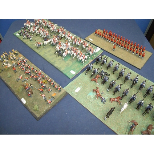 335 - Group of four cast metal military painted miniature Napoleonic war era layouts including British Cav...
