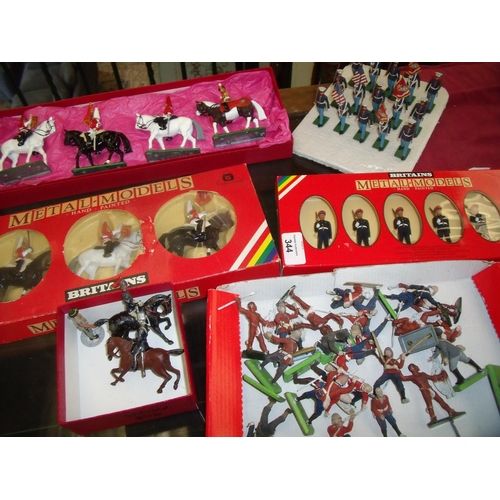 344 - Set of four Britains cast metal figures of horse guards and royal drummer, another boxed similar set...