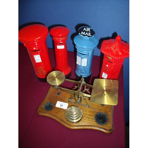 39 - Pair of brass and oak postal scales, and four ceramic Post Box money boxes (5)...