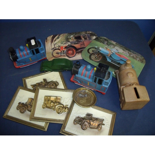 42 - Ceramic train moneybox, two Thomas the Tank Engine models, figure of a vintage car, Burrell Traction...