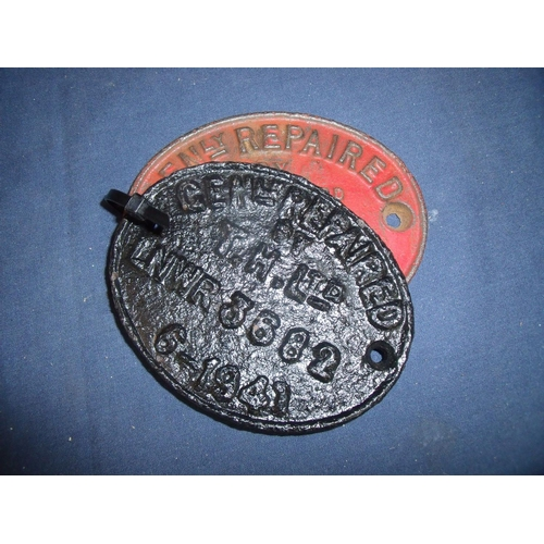 54 - Two cast metal oval carriage plates, one marked 1979 and the other 1941 (2)...