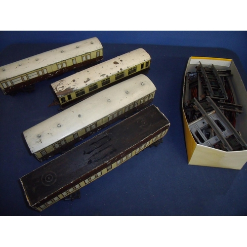 99 - Selection of O gauge railway carriages and a box of various tracks, buffer etc....