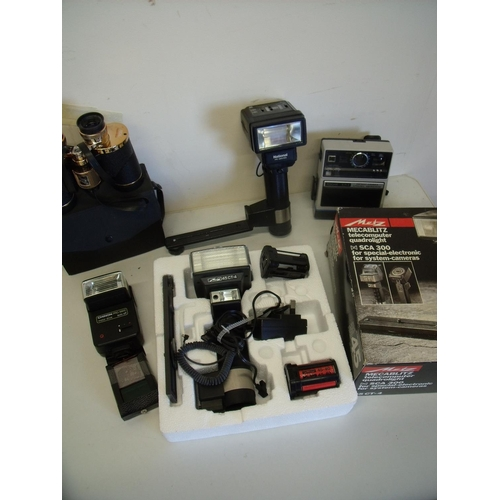 13 - Box of various flash guns, binoculars and cine equipment including a boxed Metz 45 CT4 flash gun...