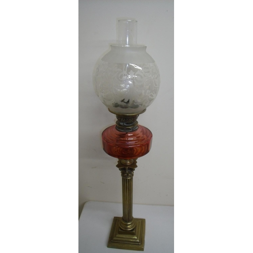 89 - Brass Corinthian column oil lamp with red glass reservoir and etched shade (80cm high)...
