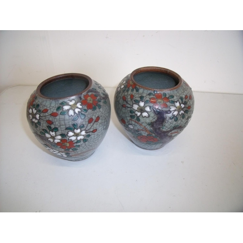 27 - Pair of Chinese crackleglaze vases (height 12cm) A/F...