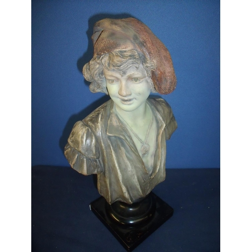 21 - Goldschneider head and shoulder bust of a young boy, mounted on turned ebonised base with impressed ...