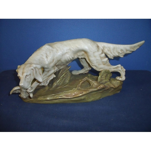 22 - Royal Dux figure of a Setter dog with pheasant, with impressed number to the base '1685' (height 15c...