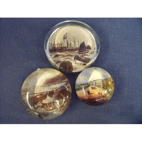 28 - Set of three souvenir glass paperweights depicting Scarborough and Filey...
