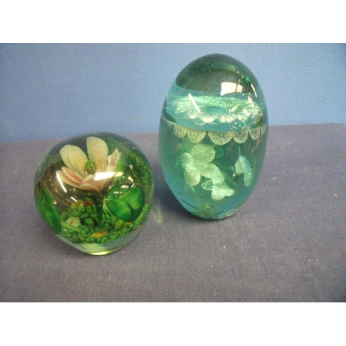 29 - Victorian green glass floral pattern dump (height 12cm) and another similar glass dump (2)...