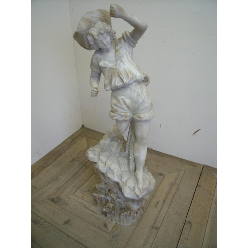 67 - Early 20th C carved alabaster figure of a boy fishing, mounted on carved rocky outcrop (94cm high) (...