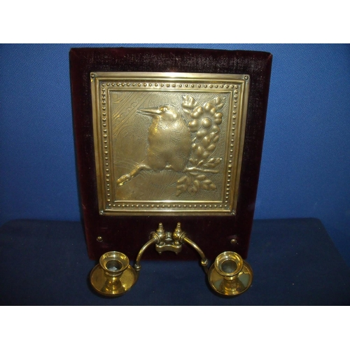 78 - Early - mid 20th C embossed brass wall plaque depicting a bird and twin branch candlesticks, mounted...