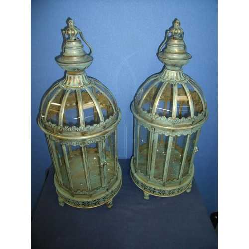 87 - Pair of large modern metal and glazed circular floor lanterns, with carry handles (height 60cm)...