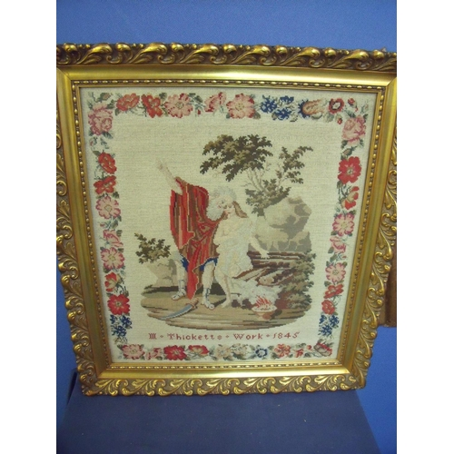 93 - Gilt framed and mounted mid 19th C woolwork sampler depicting couple in landscape scene within flora...