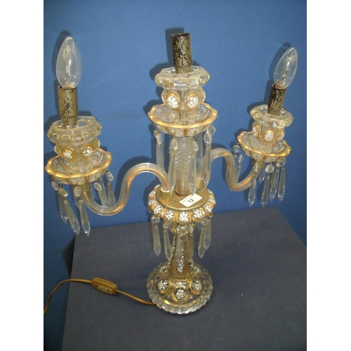 12 - Early 19th C moulded glass twin branch table lamp with painted and gilt detail (54cm high)...