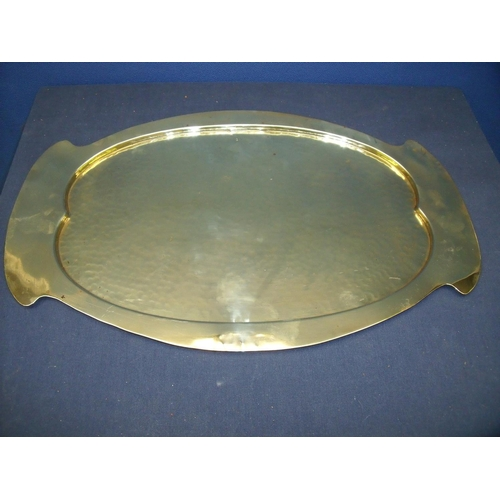 36 - Art Nouveau oval brass tray, the central panel with hammered detail (51cm x 32cm)...