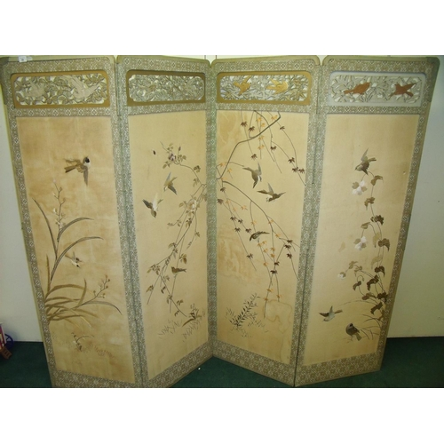 39 - Early - mid 20th C four sectional folding Oriental screen, with wooden framework and top carved fret...
