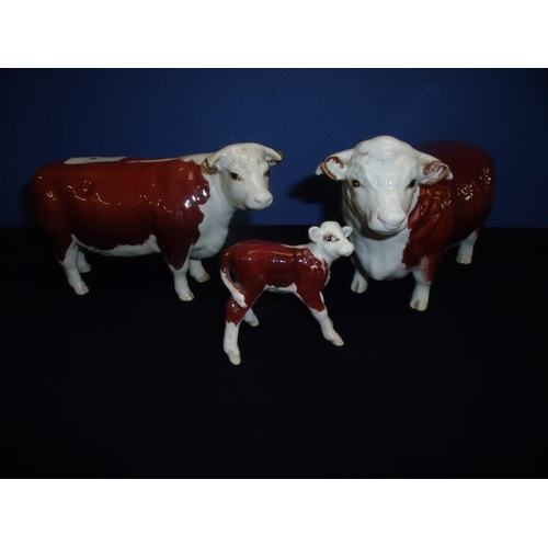 4 - Beswick Hereford cattle group comprising of Champions of Champions bull, cow and calf (3)...