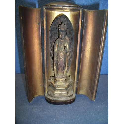59 - 19th C lacquered Tibetan style travelling icon, enclosed by two hinged doors revealing Buddhist styl...