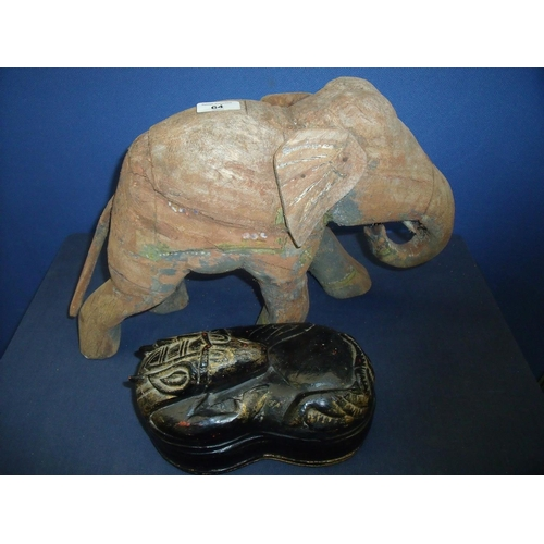 64 - Carved wood pine style elephant with traces of painted detail (29cm high) and a lacquered kidney sha...