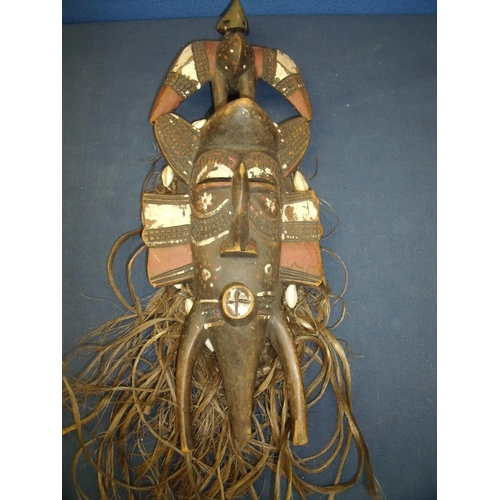 65 - 19/20th C carved wood tribal face mask with traces of painted detail, additional hair and shell work...