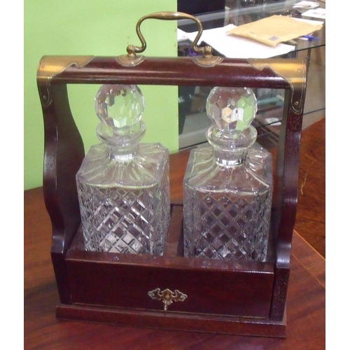 37 - Modern mahogany style and brass mounted two decanter Tantalus, with a pair of square moulded glass d...
