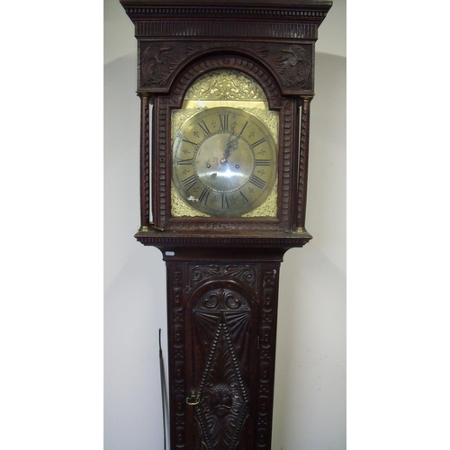 499 - Heavy carved oak cased 8 day brass faced long case clock...