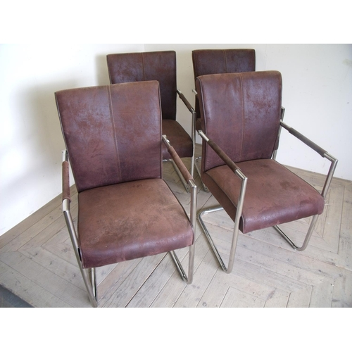 23 - Set of four modern design brown suede and chrome framed dining chairs...