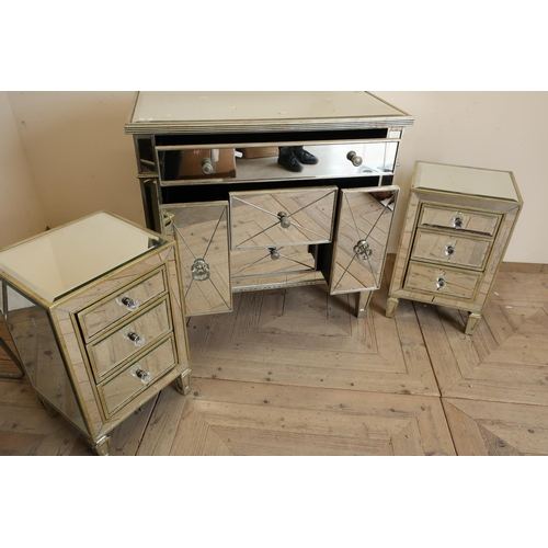 32 - Mirror finished bedroom style chest of one long above of two short drawers flanked by slide out comp...