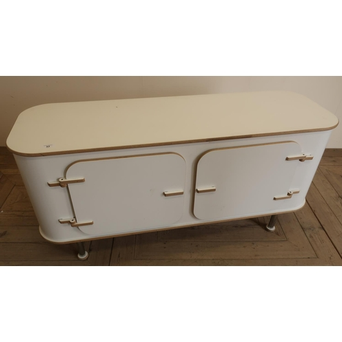 33 - Early 1970s style retro white laminate side cabinet on chromed legs...
