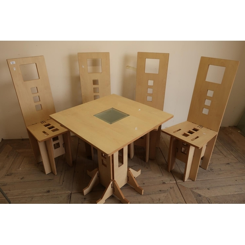 34 - Unusual set of four puzzle style dining chairs and a matching table with glass insert...