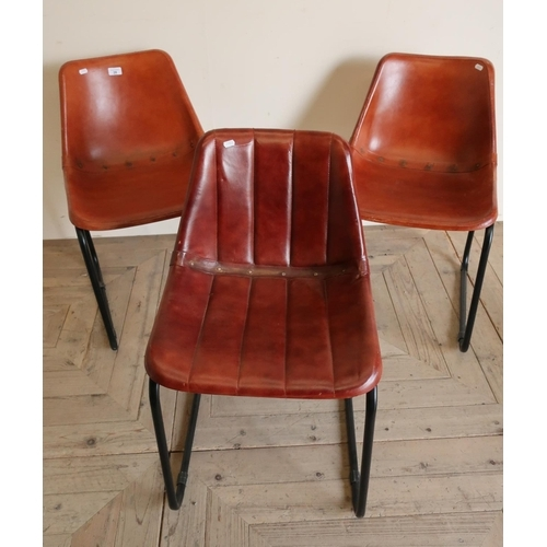 28 - A matching pair and another similar vintage  leatherette covered chairs (3)...