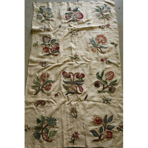 16 - 19th C Crewel work embroidered panel depicting various flowers and insects (84cm x 140cm)...
