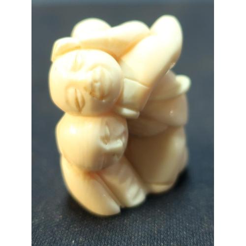 36 - Edo period Japanese carved ivory Netsuke of three crappling Buddha's with signature to the base (hei...