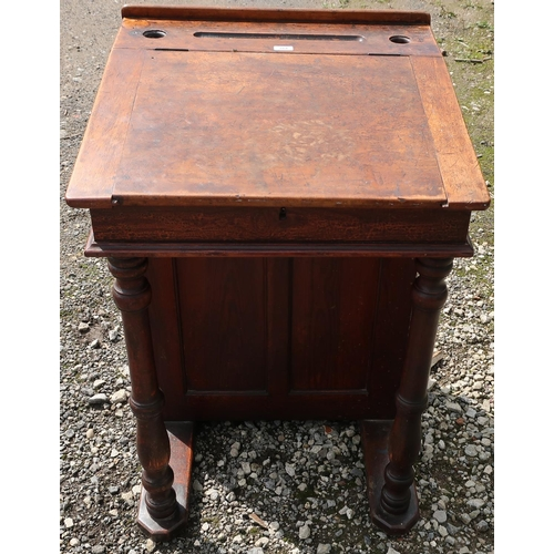 264 - Late Victorian stained pine schoolmaster's desk with lift up top, turned columns and cupboard (67cm ...