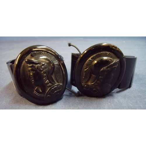 10 - Pair of similar Whitby jet bracelets with large cameo profile panel depicting a Greek style warriors...
