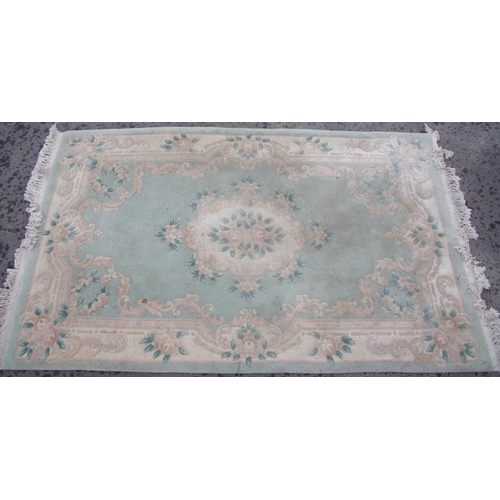 390 - Traditional Chinese embossed washed woollen rug, green ground with central floral medallion and flor...