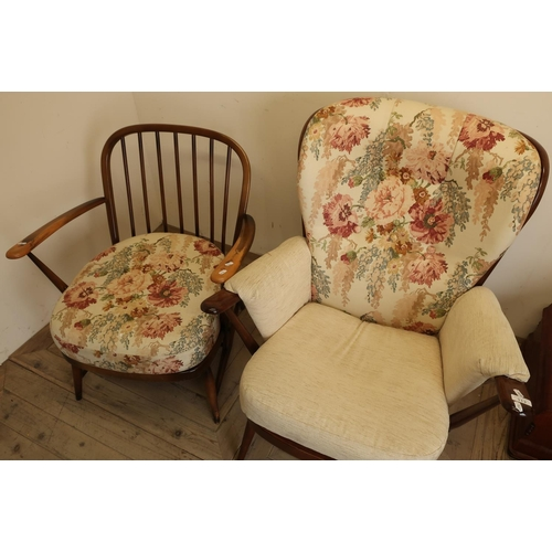 113 - Ercol dark wood armchair and another similar low seated Ercol chair (2)...