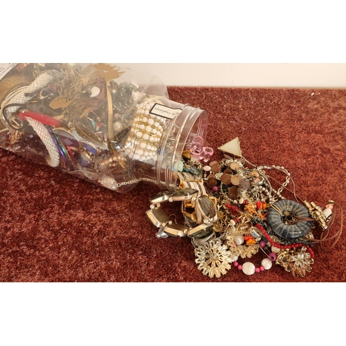 136 - Tub containing a large quantity of costume jewellery...