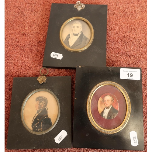 19 - Group of three 19th C ebonised framed miniature portraits of gentlemen...