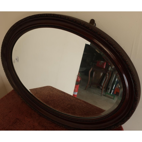 35 - 19th/20th C oval mahogany framed bevelled edge wall mirror...