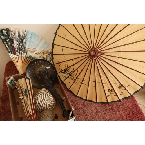 41 - Two Eastern style paper parasols, two Studio ceramic  figures, an Indian plate and a carved African ...