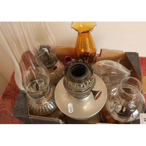 45 - Collection of various assorted oil lamps in one box...