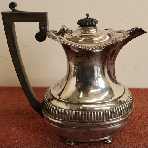 464 - Edwardian silver teapot of ballaster form, gadrooned rim with ribbed base, ebony handles and finial,...